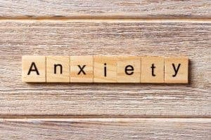 Photo of ANXIETY written on wood block | Online anxiety counseling sc and therapy online in South Carolina