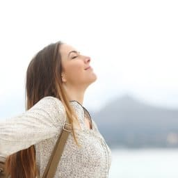 Young woman taking a moment in her day to breathe and zone in | Online therapy for anxiety | Synergy eTherapy